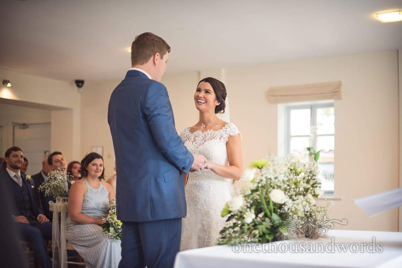 Exchange of rings during ceremony at the Italian Villa Wedding venue