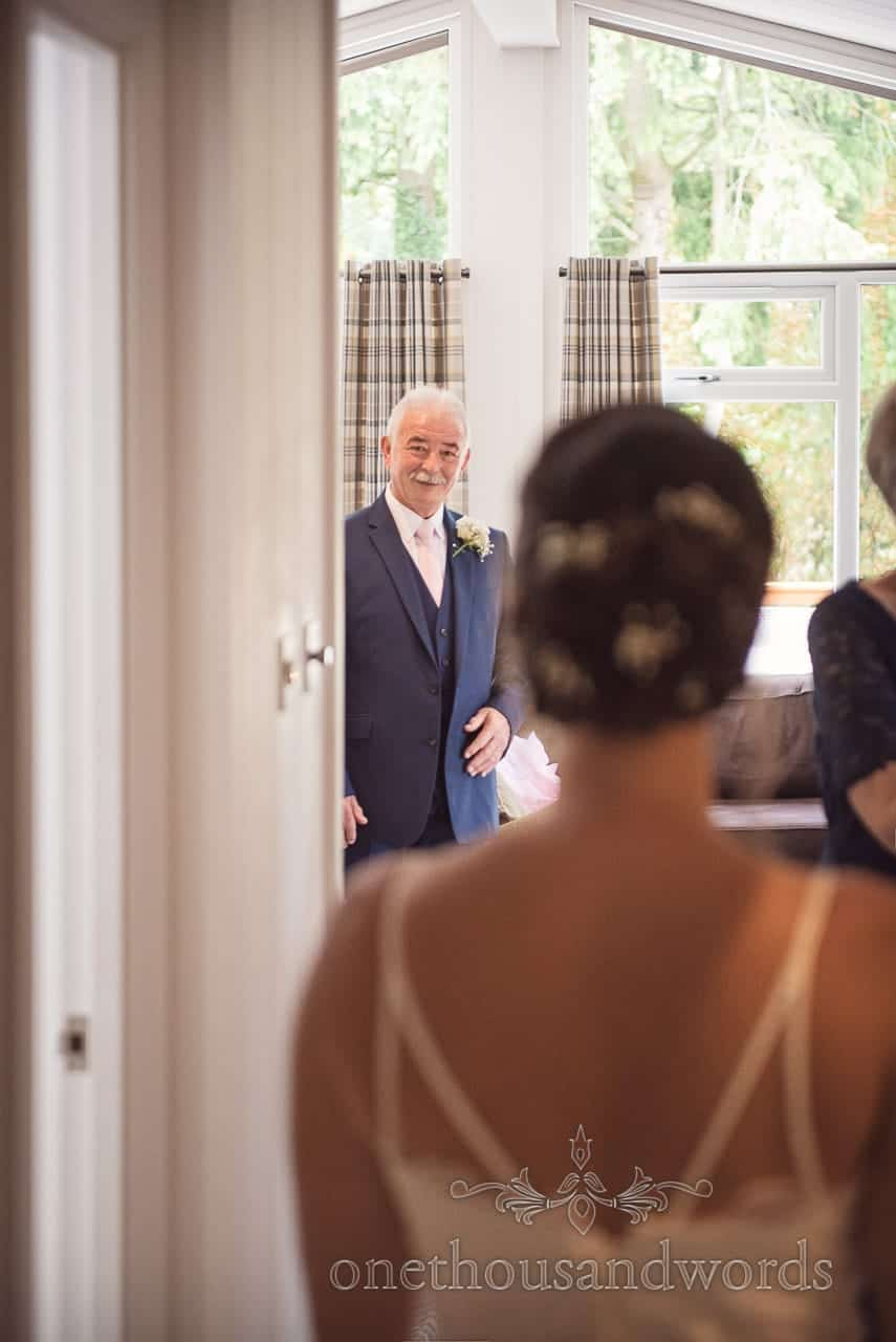 Father of the bride sees his daughter in wedding dress before Italian Villa Wedding
