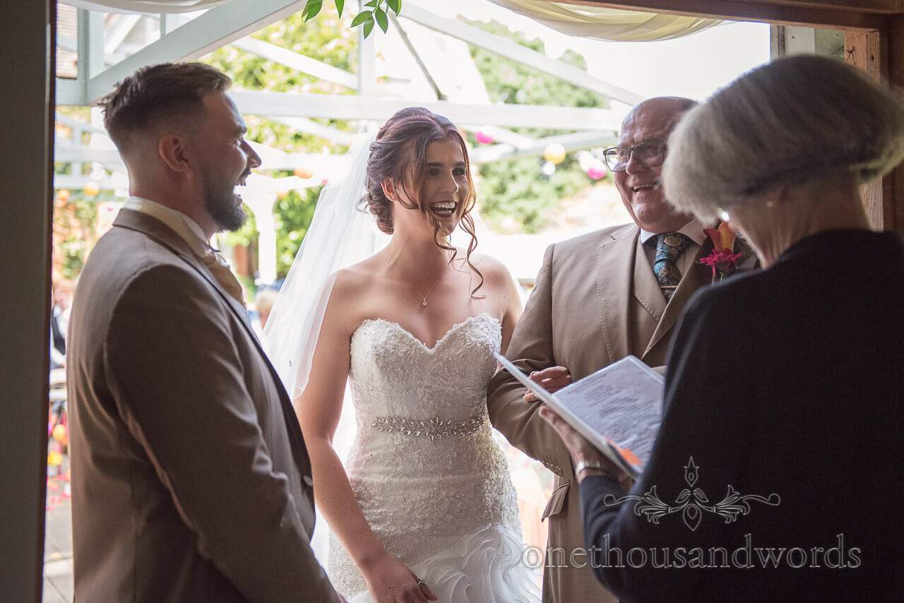 Father of bride share joke with bride and groom at Old Vicarage Wedding Photographs