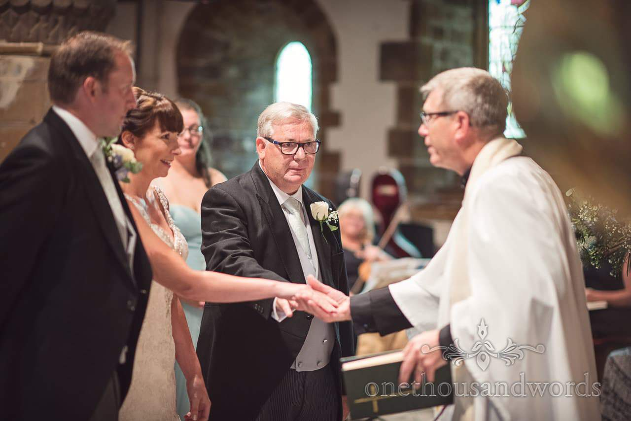 Father of the bride gives hand in marriage at Canford School Wedding Photographs