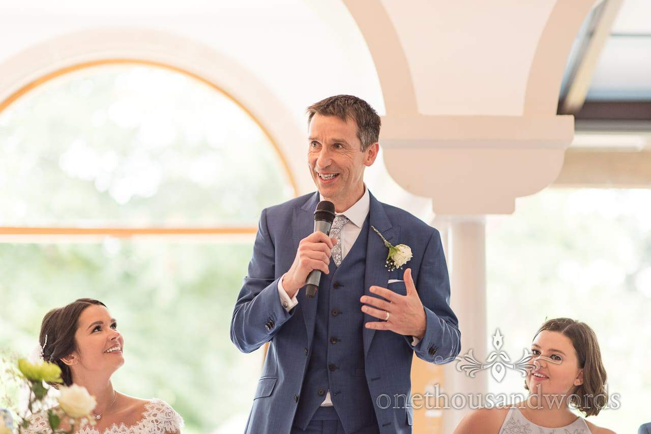 Father of the bride in blue 3 piece wedding suit delivers father of the bride speech