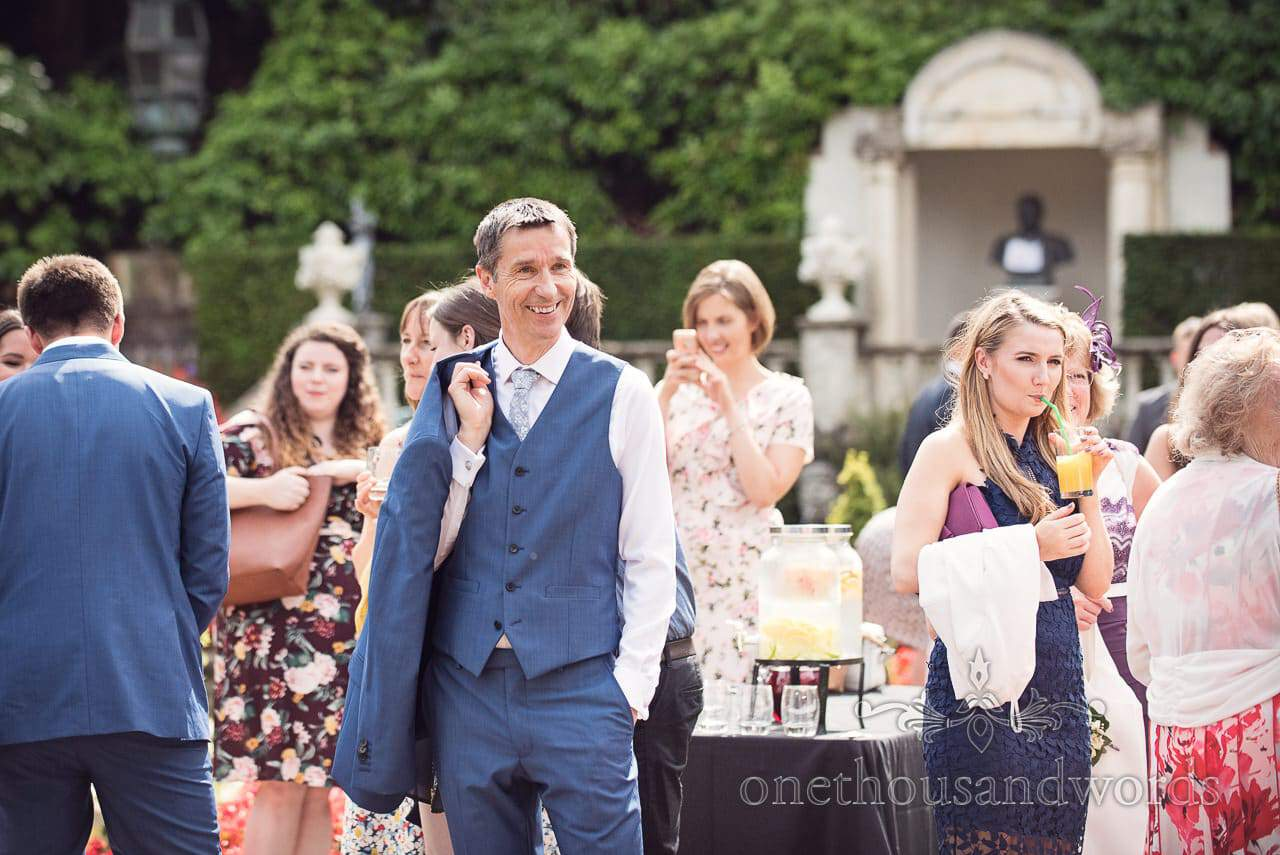 Father of the bride in blue wedding waistcoat in gardens at Italian Villa Wedding venue