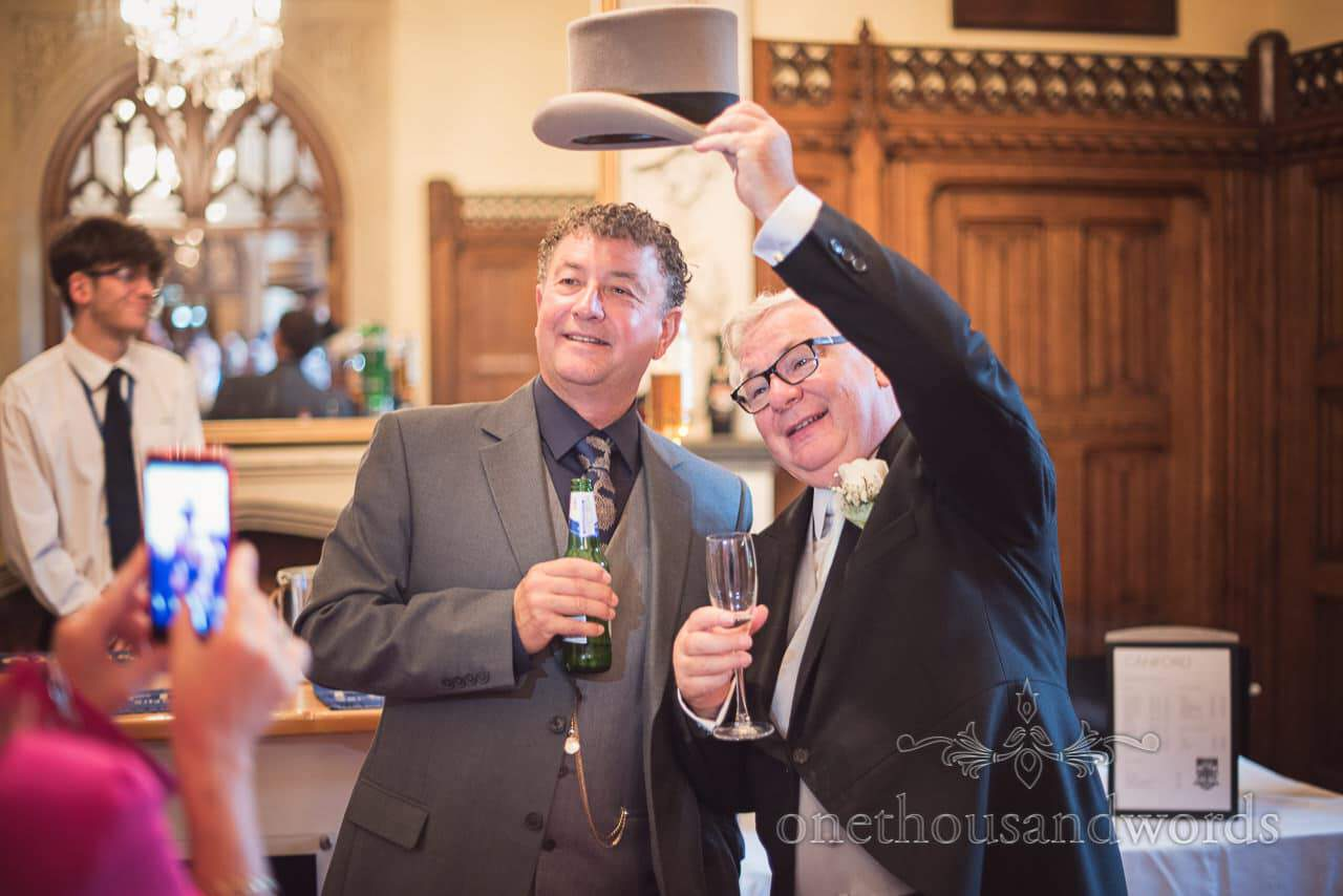 Father of the bride with guest during reception at Canford School Wedding
