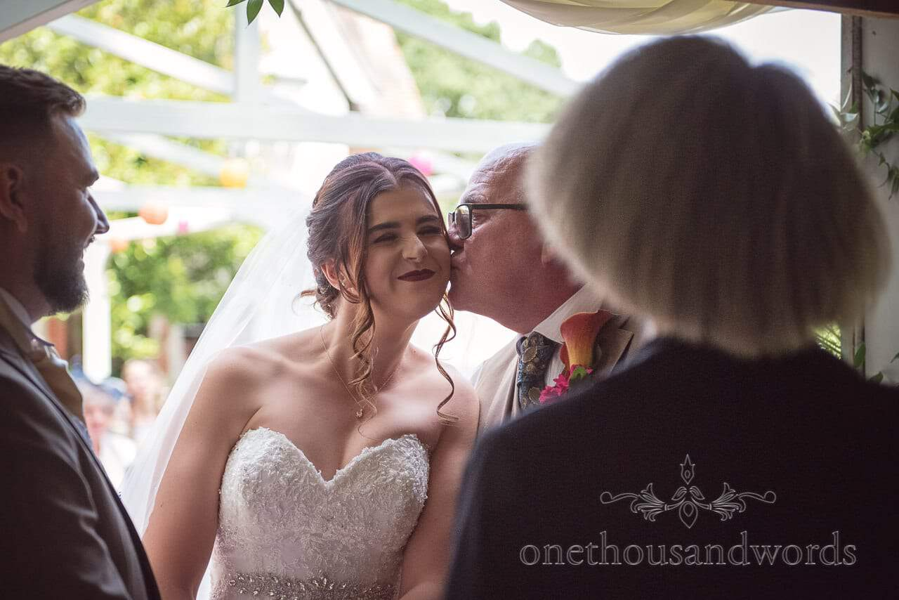 Father of the brides kisses daughter on cheek at The Old Vicarage Wedding Photographs