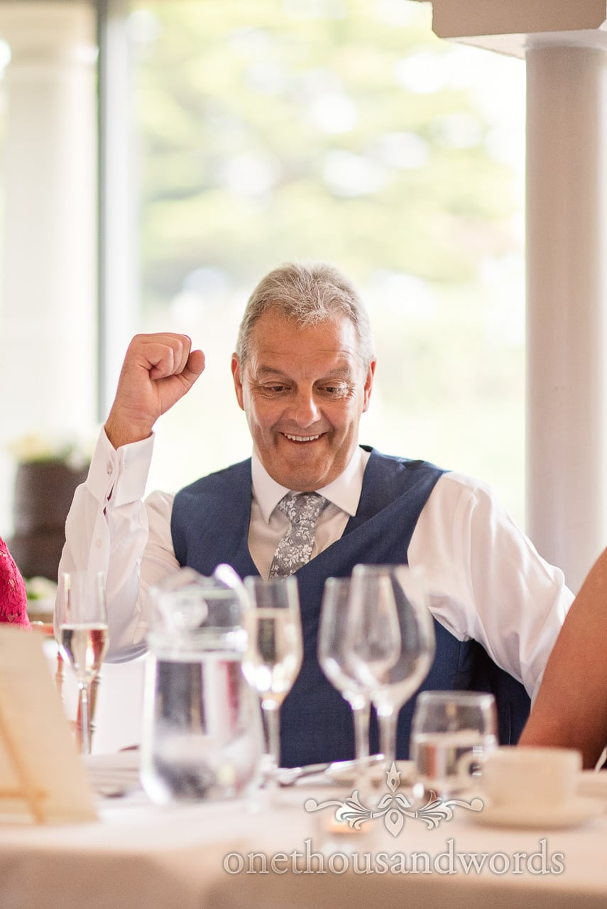 Father of the groom fist pumps the air during wedding speeches at The Italian Villa