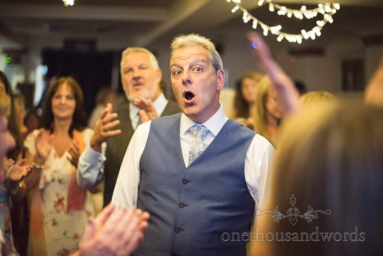Father of the groom sings and dances at The Italian Villa wedding venue, Dorset