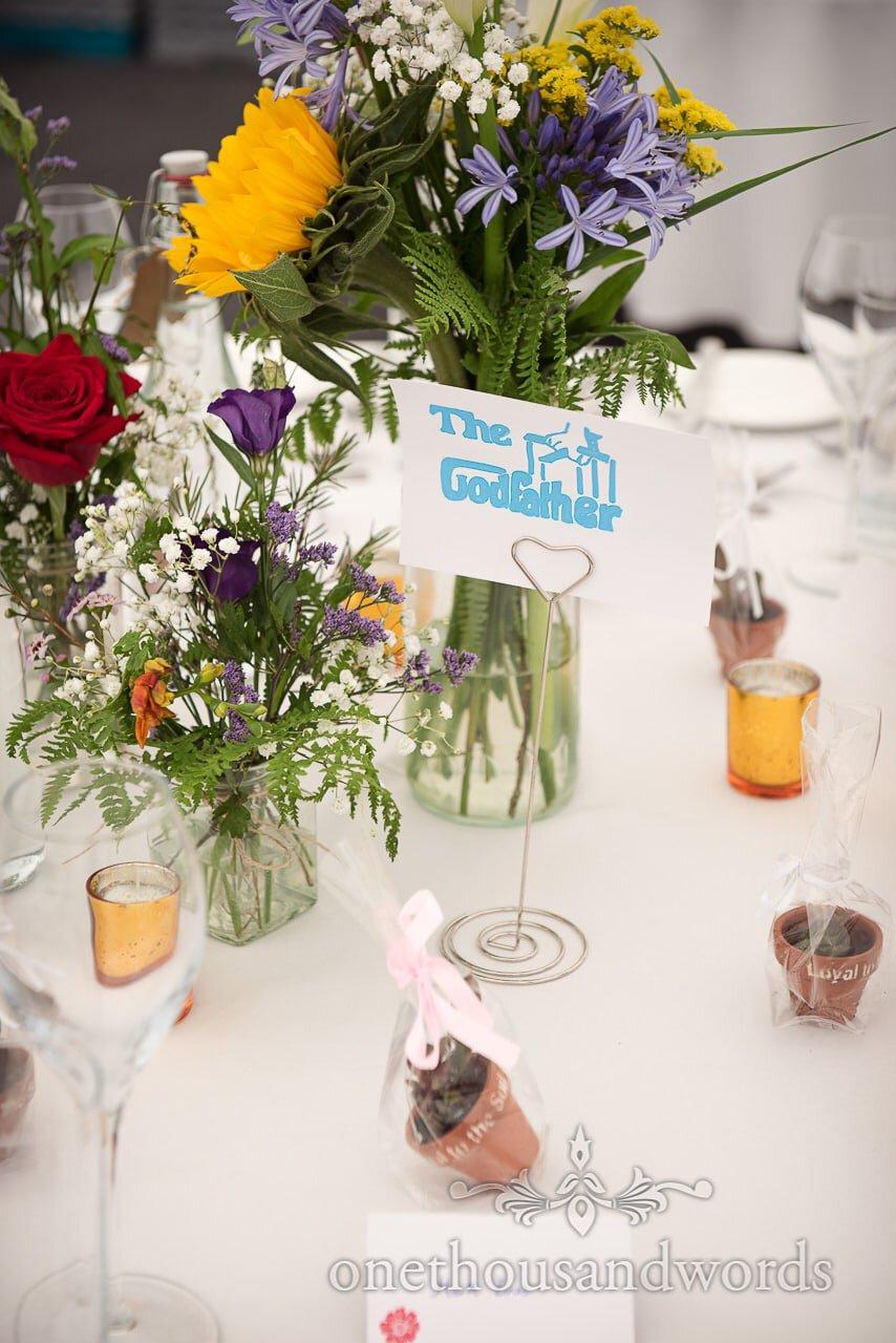 Film theme table name at Dorset garden wedding