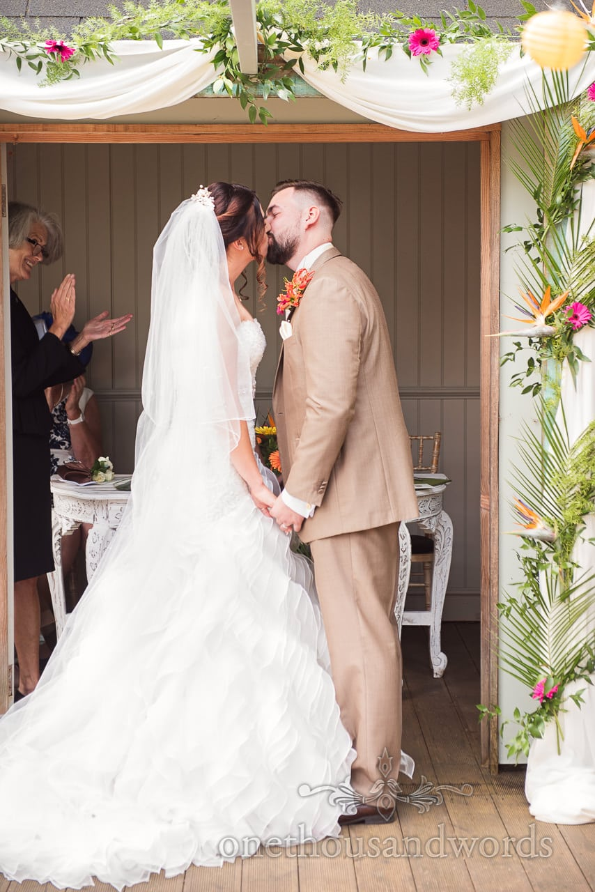 First kiss at outdoor ceremony at the Old Vicarage Wedding Photographs