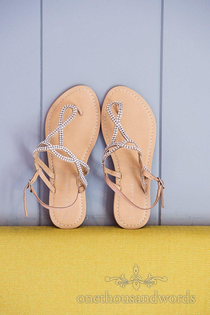 Flat wedding shoes on bedstead before Italian Villa Wedding