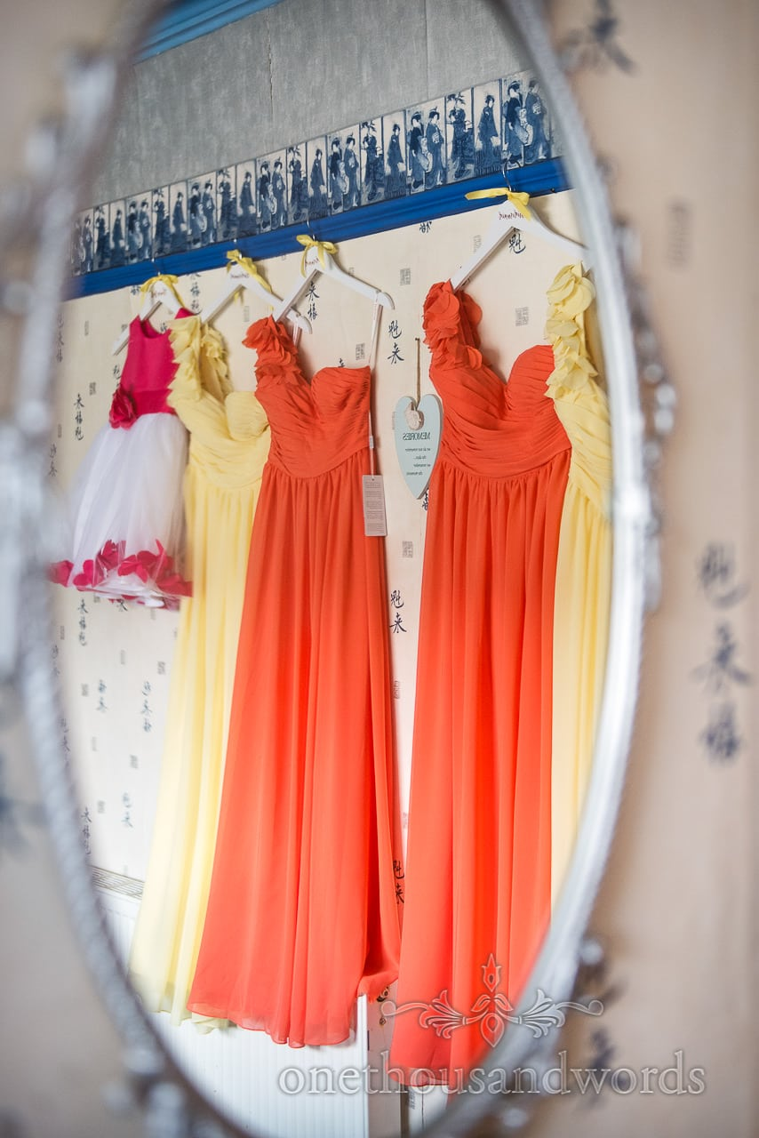 lower girl and bridesmaid dresses in mirror from Old Vicarage Wedding