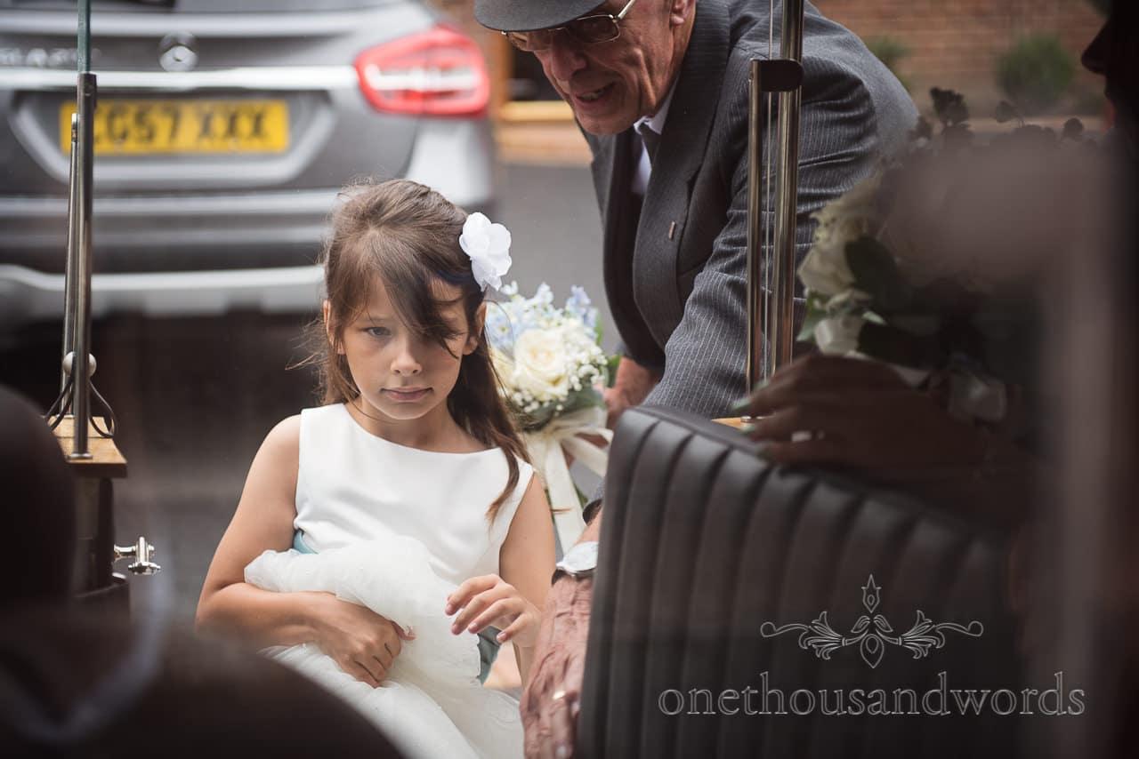 Flower girl gets into wedding car before Church Wedding