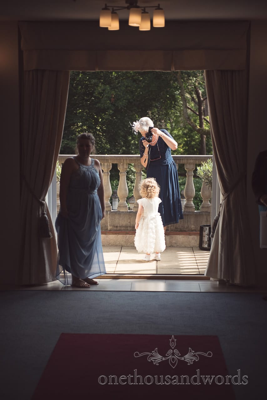 Flower girl poses for mother of the bride photographer at Italian Villa Wedding
