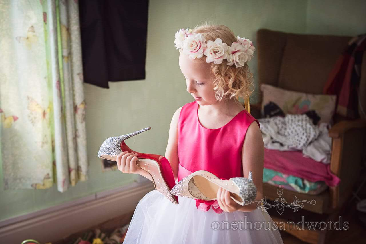 Flower girl with brides wedding shoes from Old Vicarage Wedding