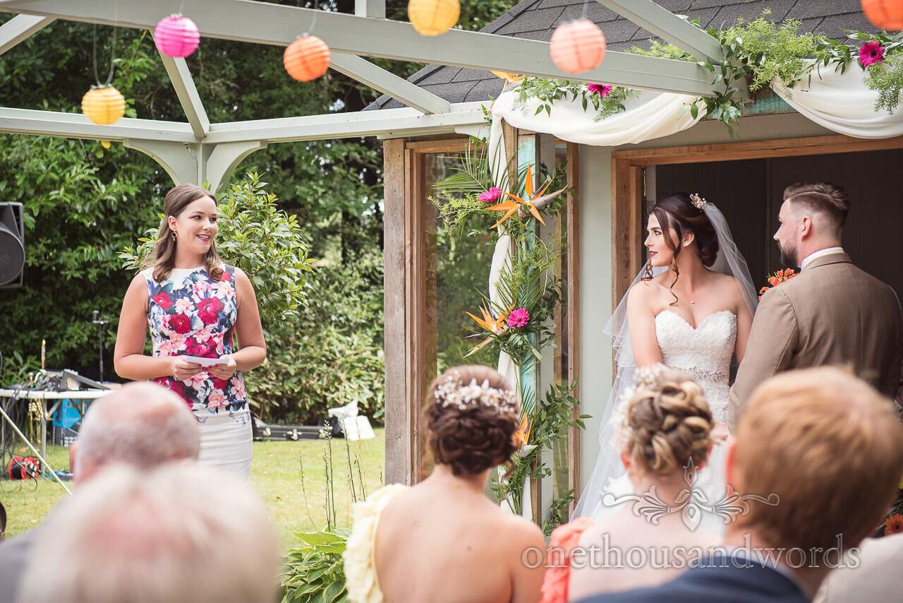 Friend gives reading during outside ceremony at Old Vicarage Wedding Photographs