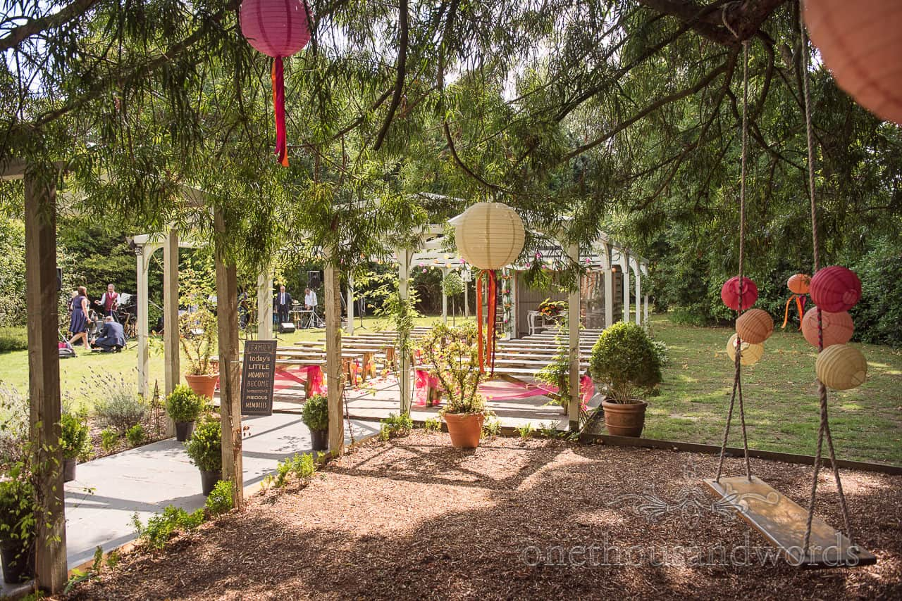 Garden and ceremony space decorated with pink.orange and yellow for The Old Vicarage Wedding Photographs