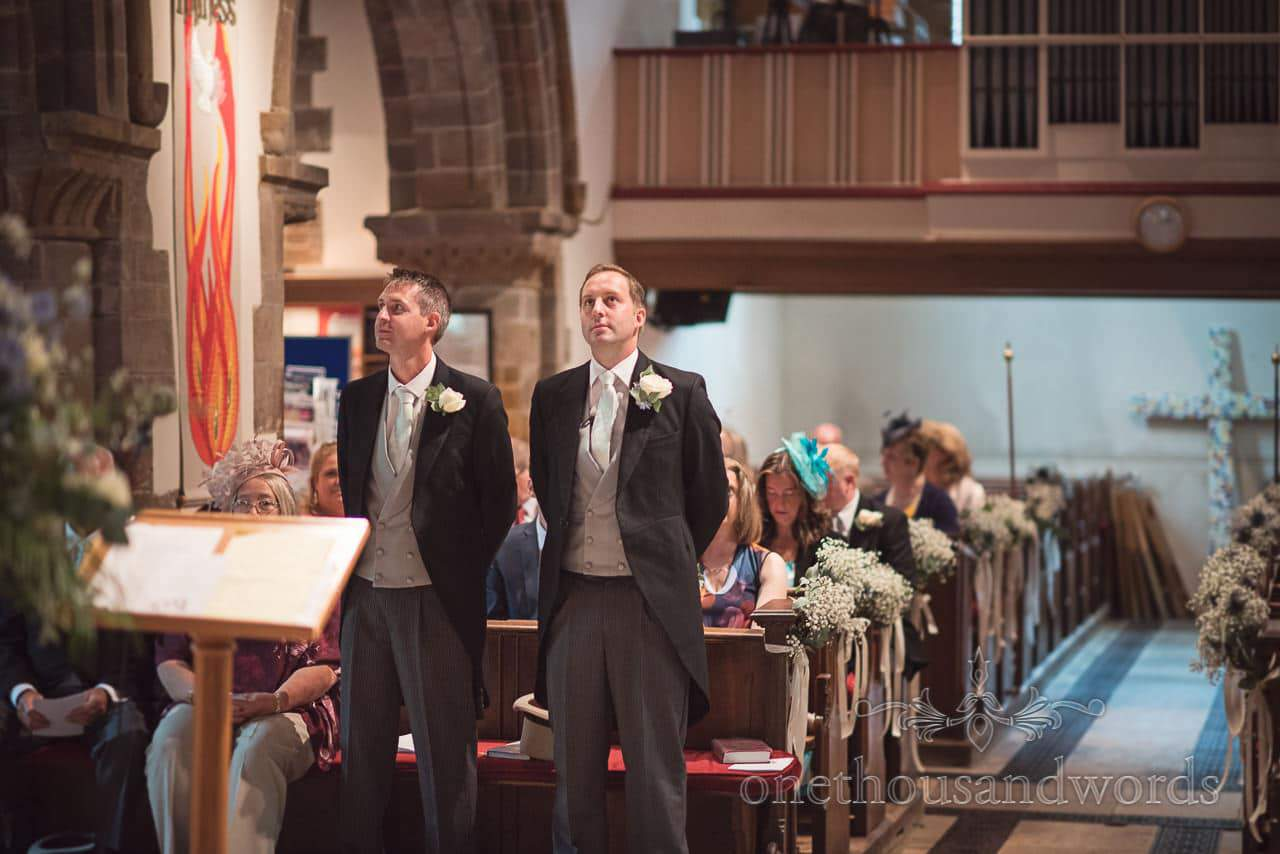 Groom and best man await the arrival of bridal party at Canford School Wedding Photographs