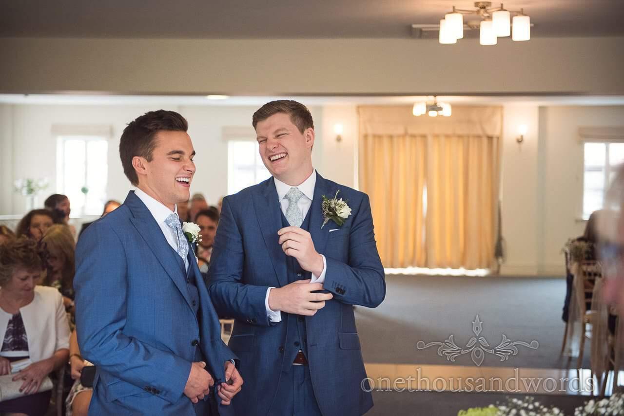 Groom and best man share a joke at Italian Villa Wedding venue