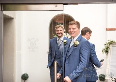 Groom and groomsmen in blue suits at Italian Villa Wedding venue