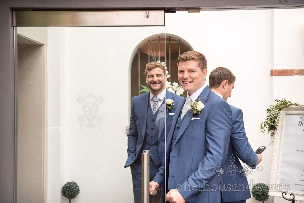 Groom and groomsmen in blue suits at Italian Villa Wedding venue