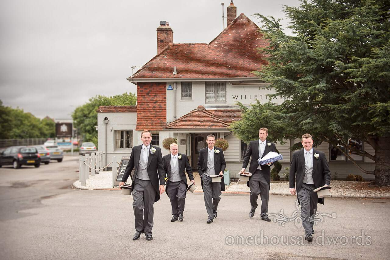 Groom and groomsmen leave for church from Canford School Wedding