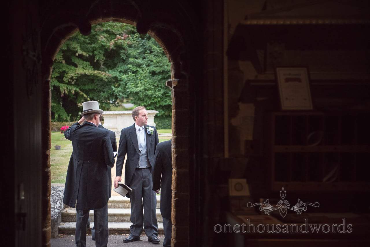 Groom and groomsmen outside church at Canford School Wedding