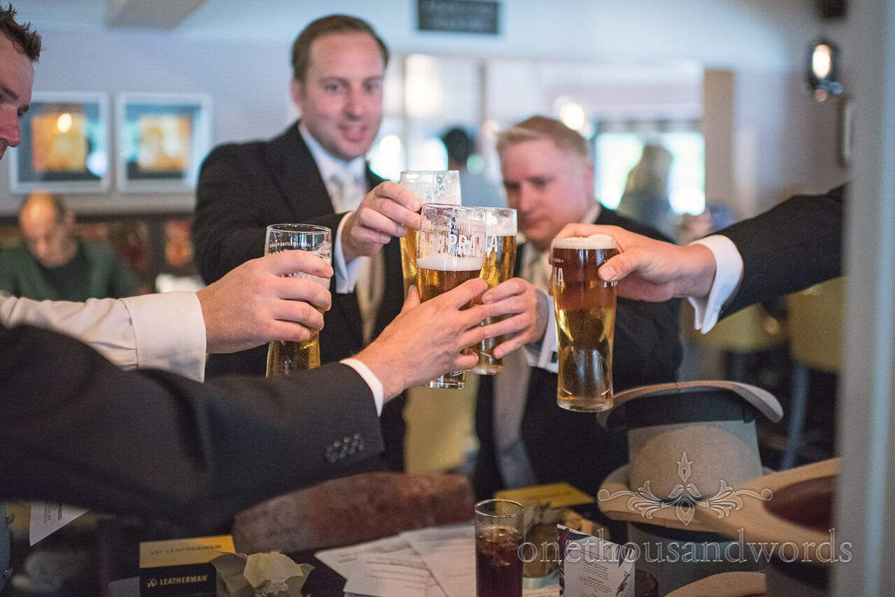 Groom and groomsmen raise a toast before Canford School Wedding
