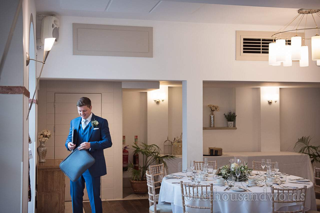 Groom arranging final details at Italian Villa Wedding venue