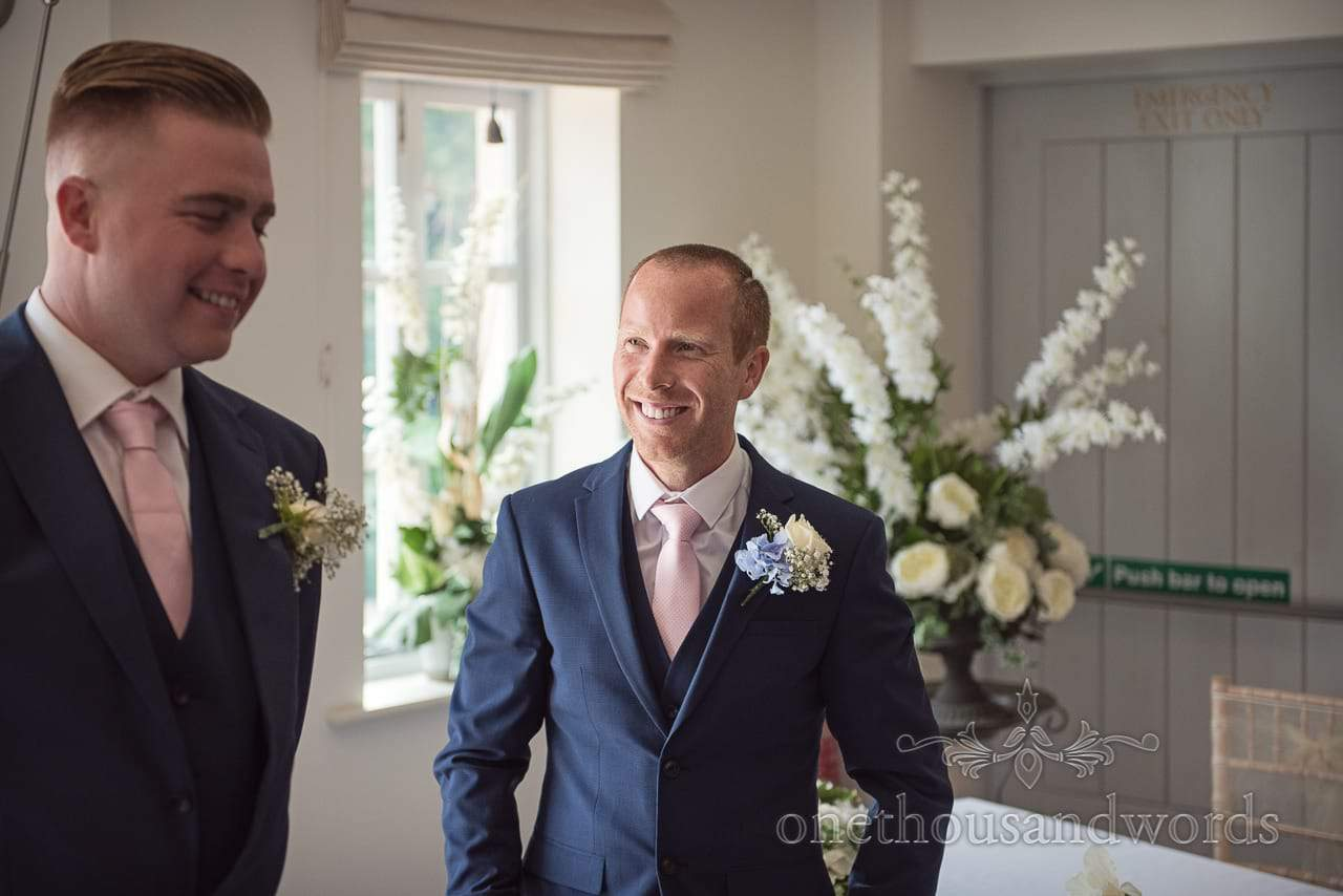 Groom and best man await the arrival of bridal party at Italian Villa Wedding venue Photos