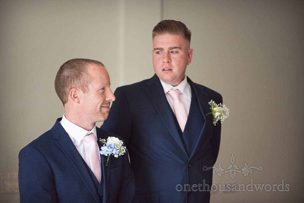 Groom and best man await the arrival of the bridal party at Italian Villa Wedding