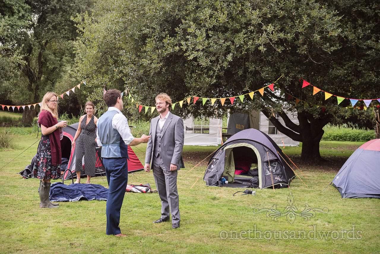 Groom greets wedding campers at Dorset garden wedding