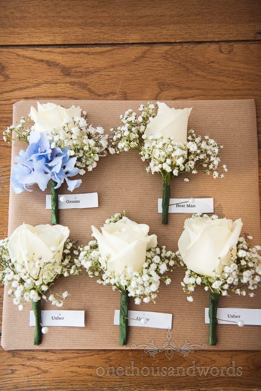 Groom and groomsmen floral buttonholes from Italian Villa Wedding