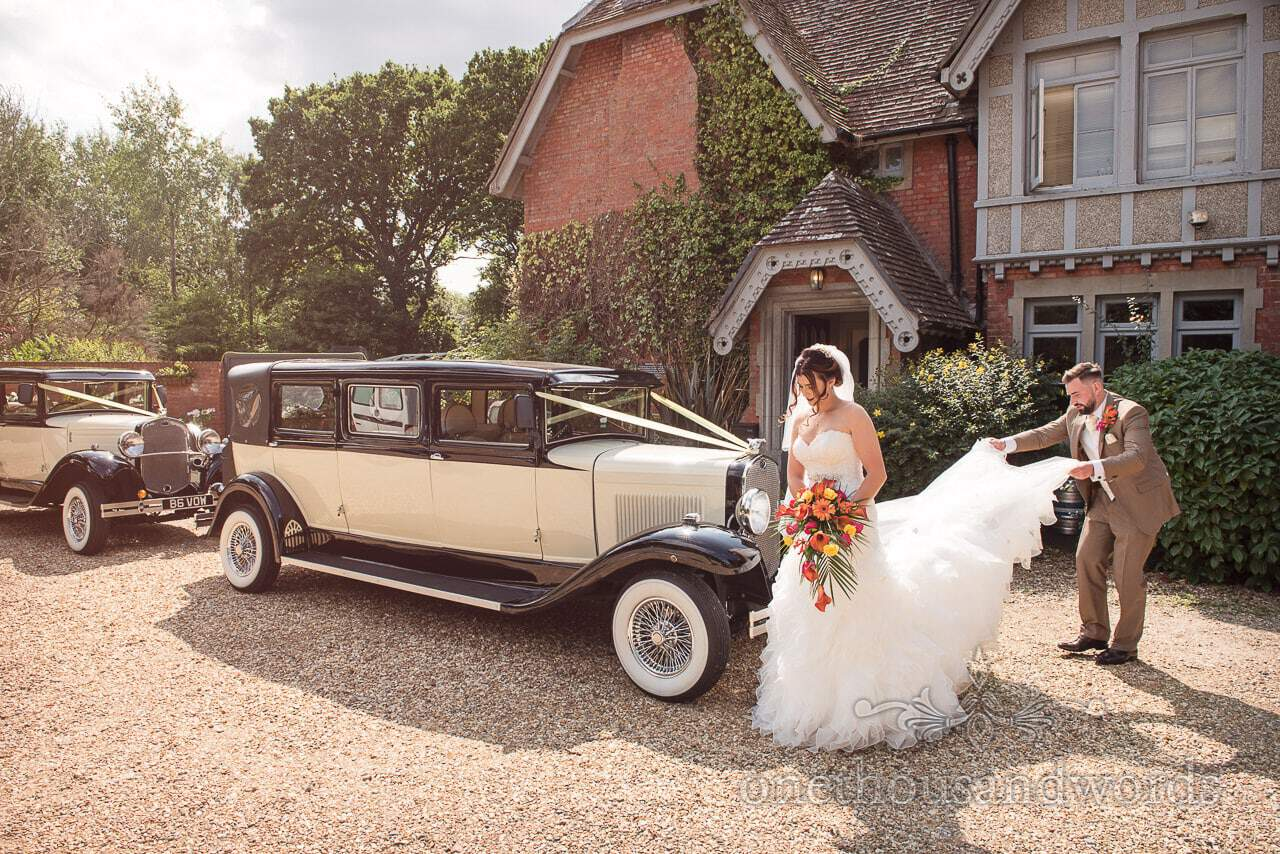 Groom helps bride with dress at The Old Vicarage Wedding Photographs