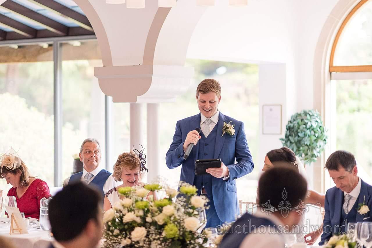 Groom in blue wedding suit give grooms wedding speech at Italian Villa wedding
