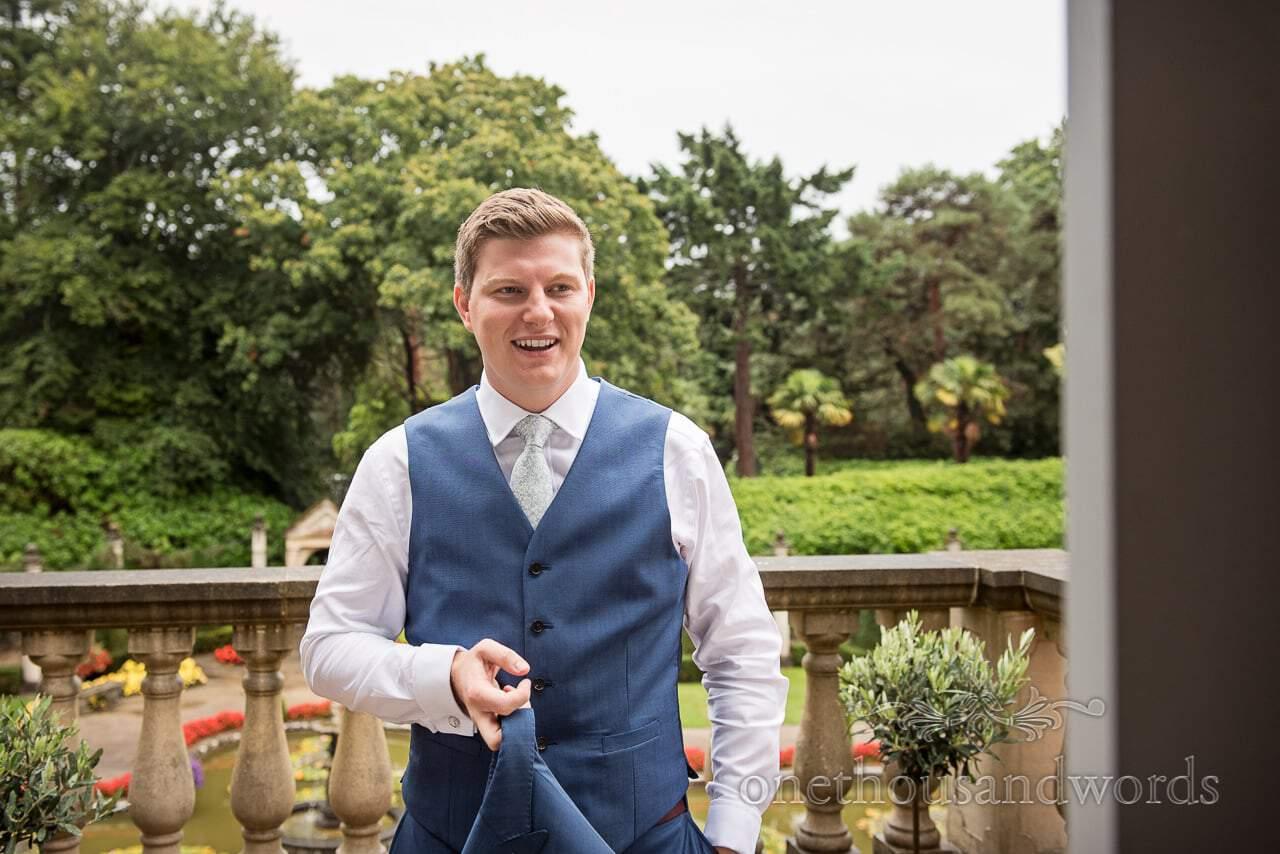 Groom in wedding suit feels the heat at Italian Villa Wedding venue