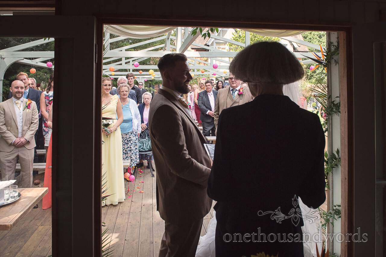 Groom laughs during outdoor ceremony at he Old Vicarage Wedding