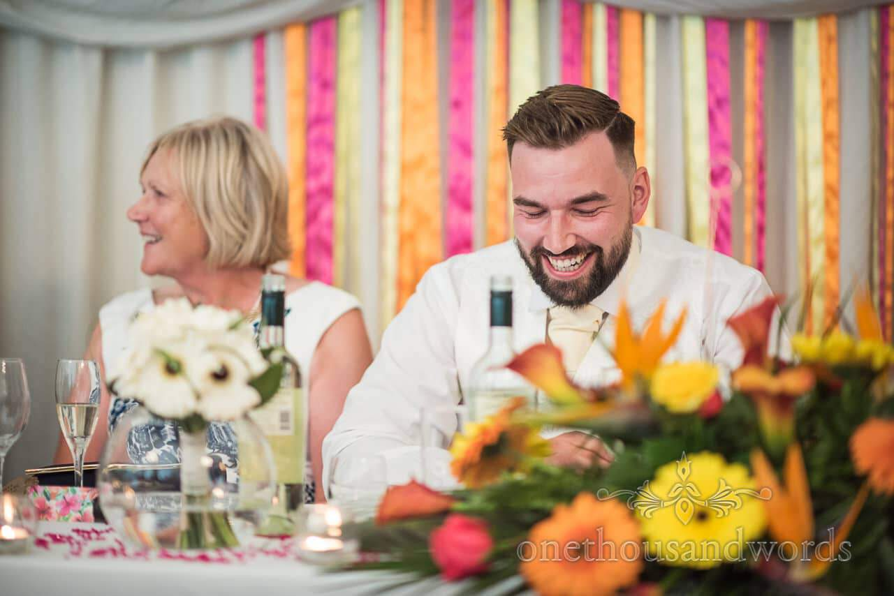 Groom laughs during speeches at The Old Vicarage Wedding Photographs