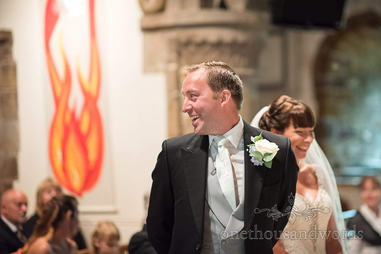 Groom looks around during church ceremony at Canford School Wedding