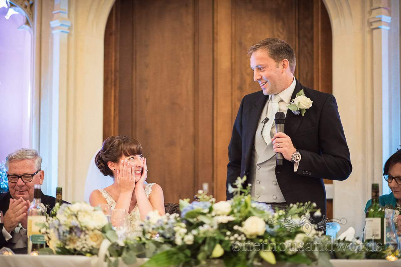 Groom looks at his bride during wedding speech at Canford School Wedding