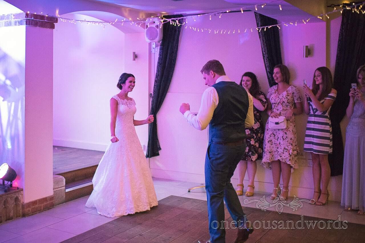 Groom moonwalks onto dance floor for first dance with his new bride
