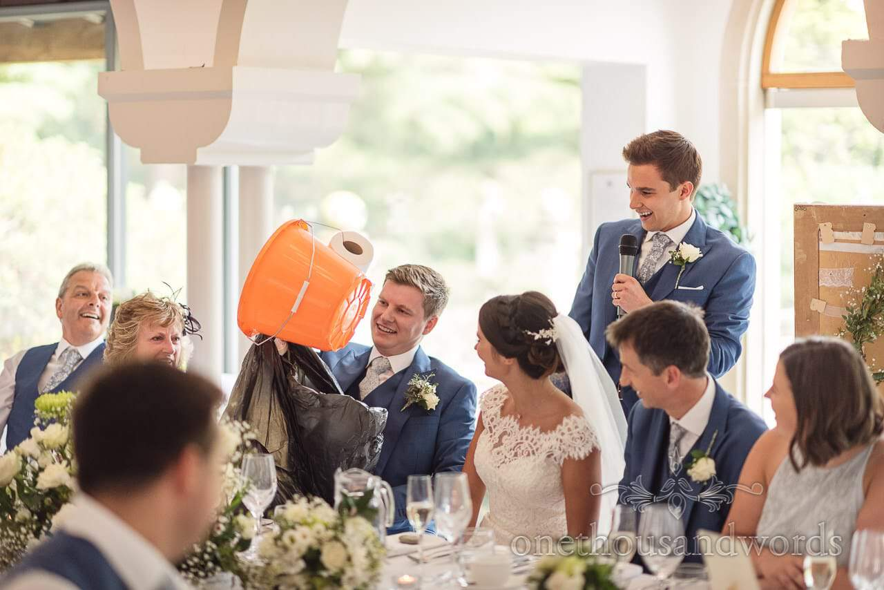 Groom receives surprise bucket and toilet roll during hilarious best man's speech