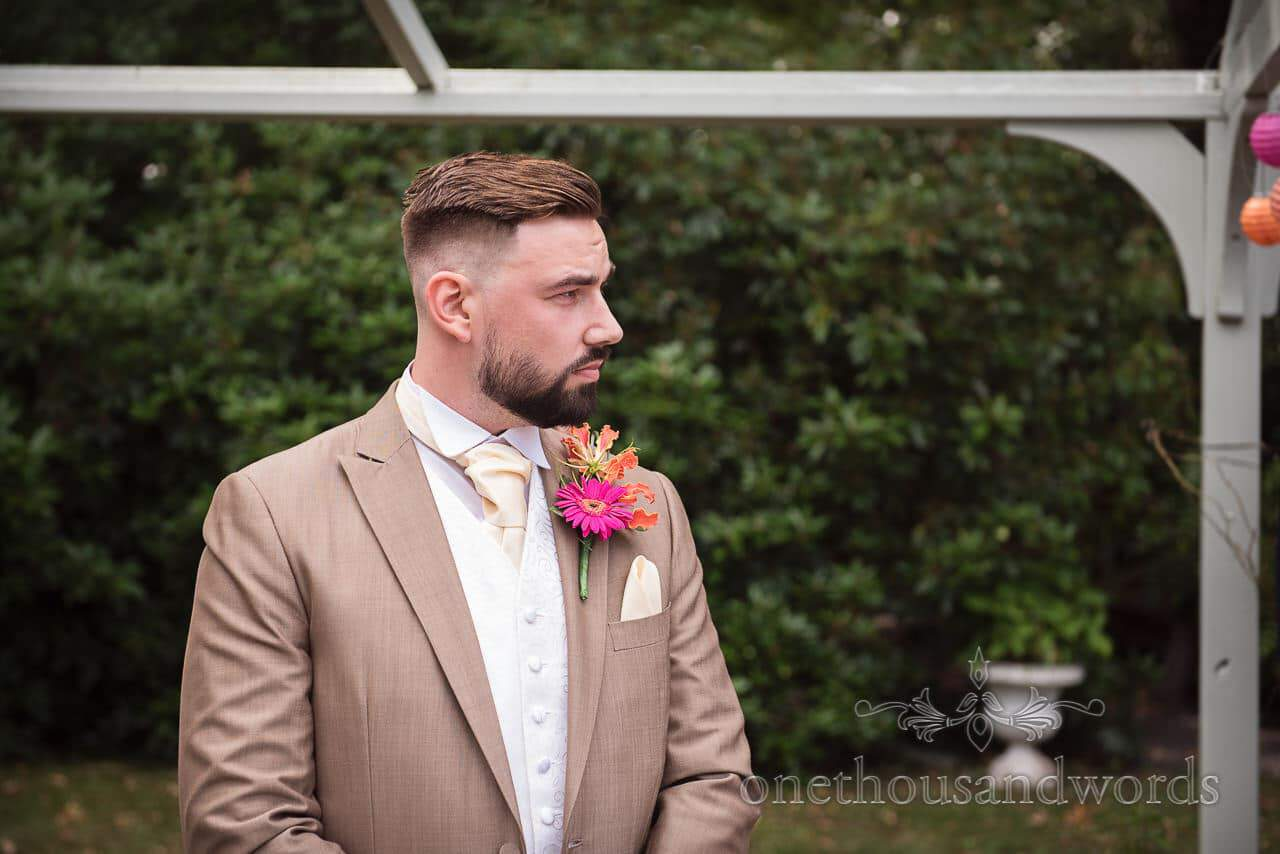 Groom waits before outdoor ceremony at the Old Vicarage Wedding Photographs