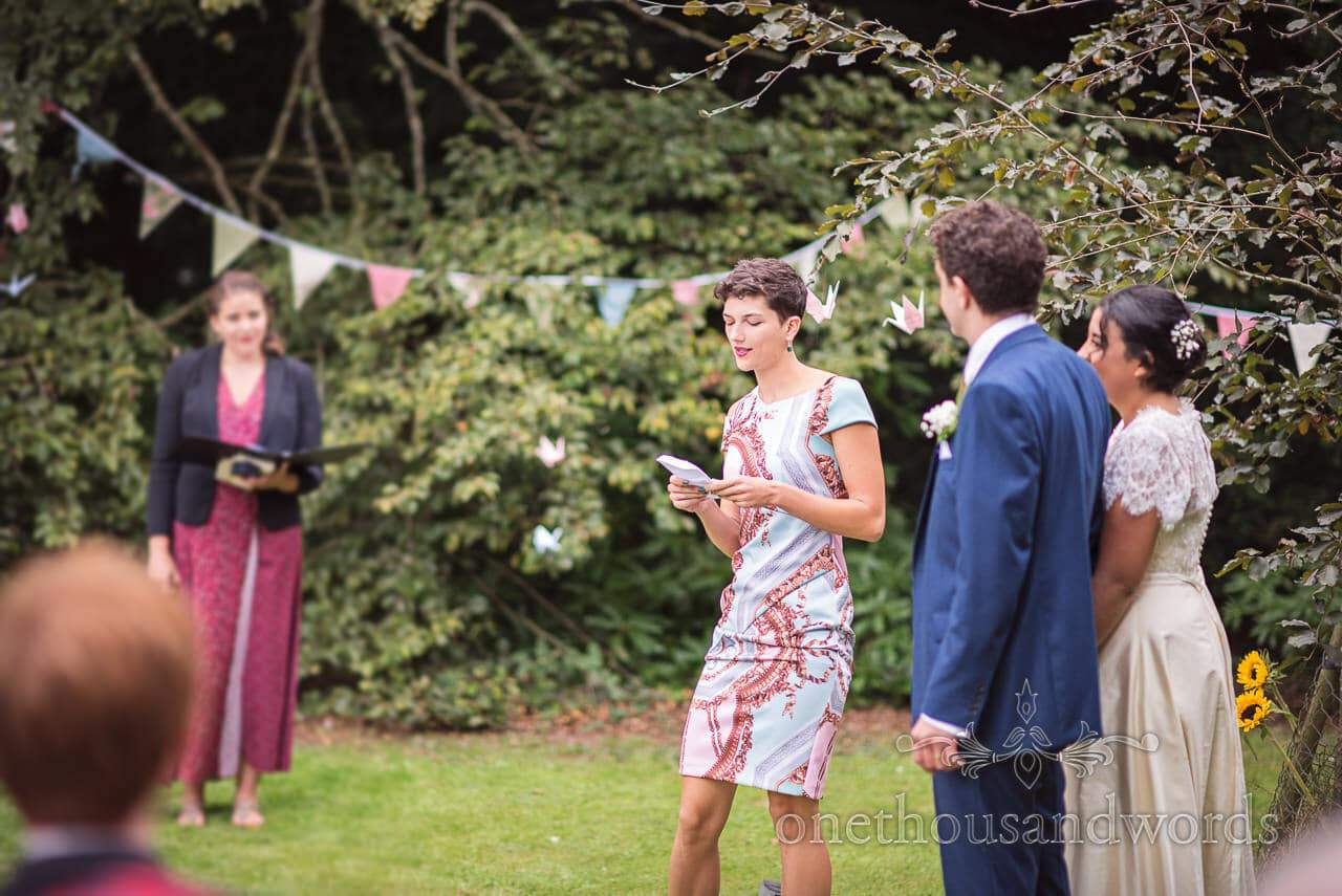 Grooms sister delivers reading during garden ceremony