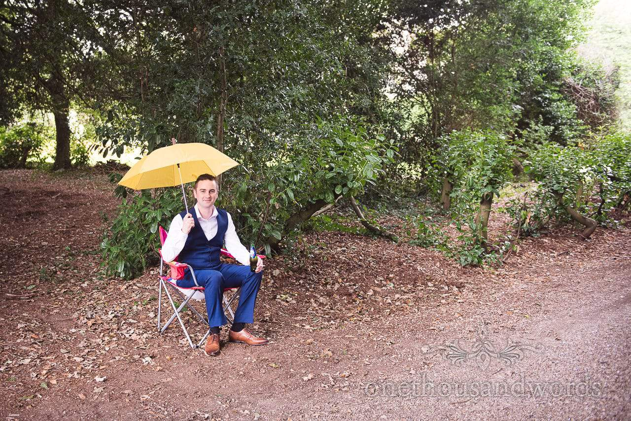 Groomsman on car park duties at Dorset garden wedding