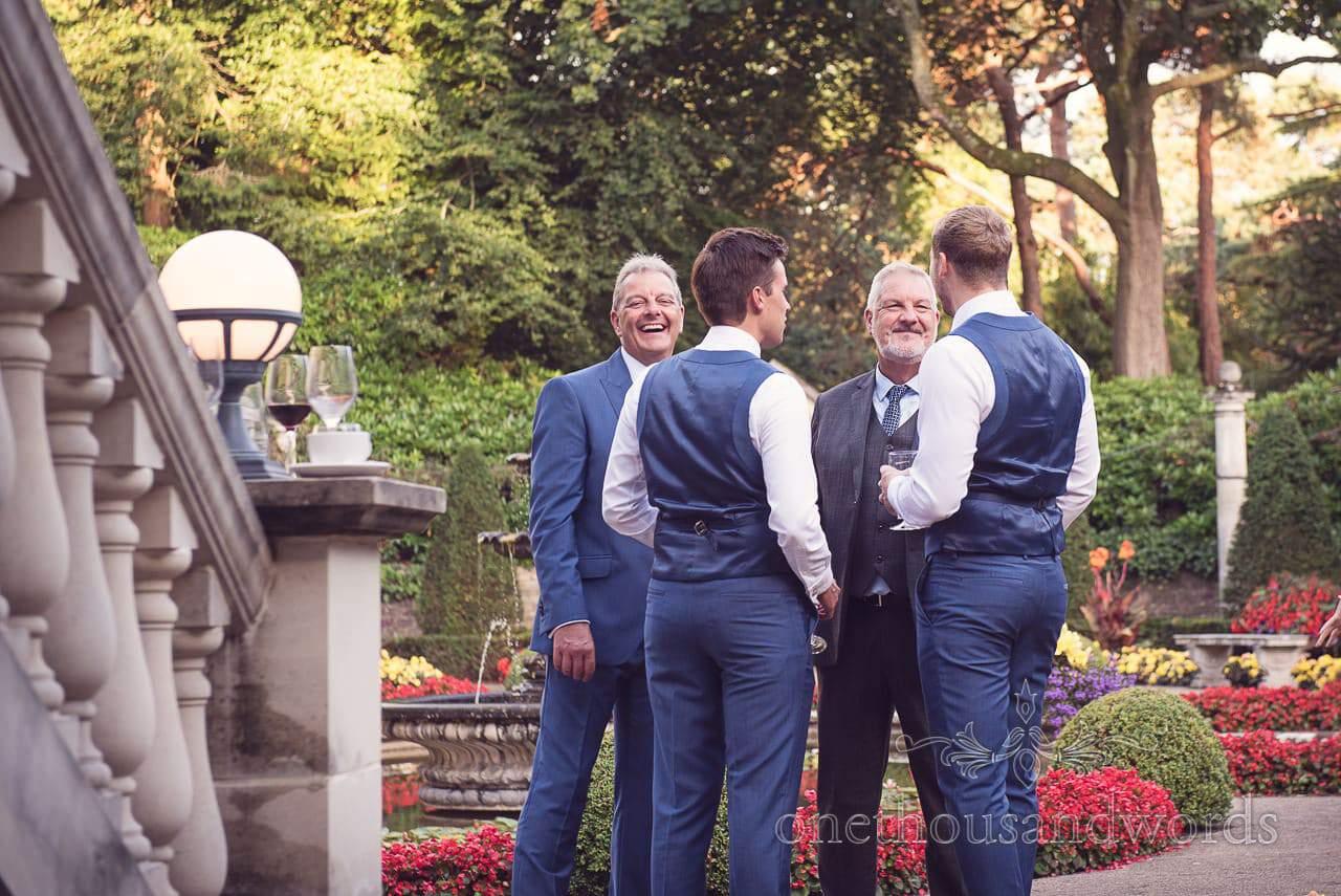 Groomsmen enjoy sunset drinks in The Italian Villa Wedding venue gardens