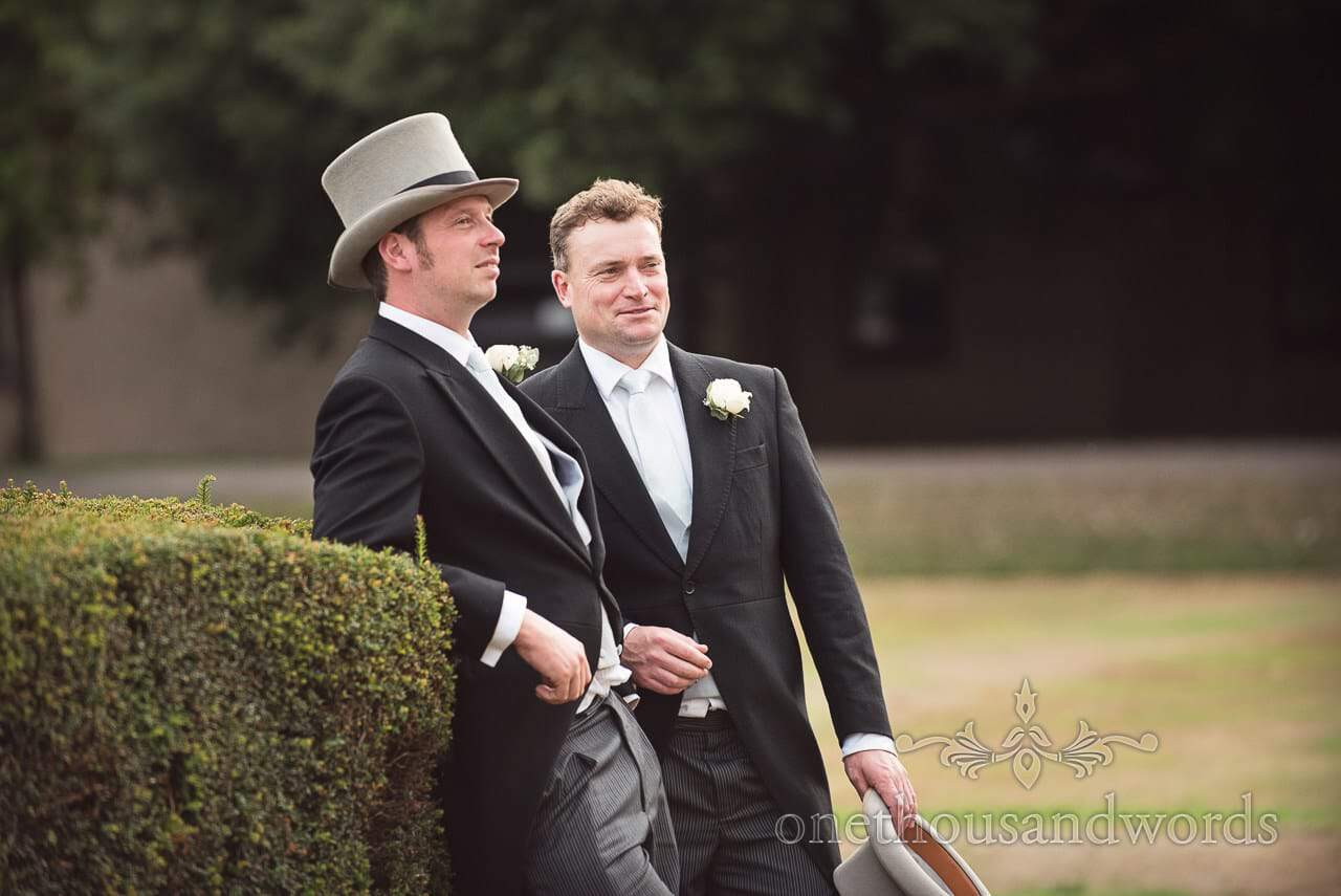 Groomsmen in top hat and tails at manor house wedding