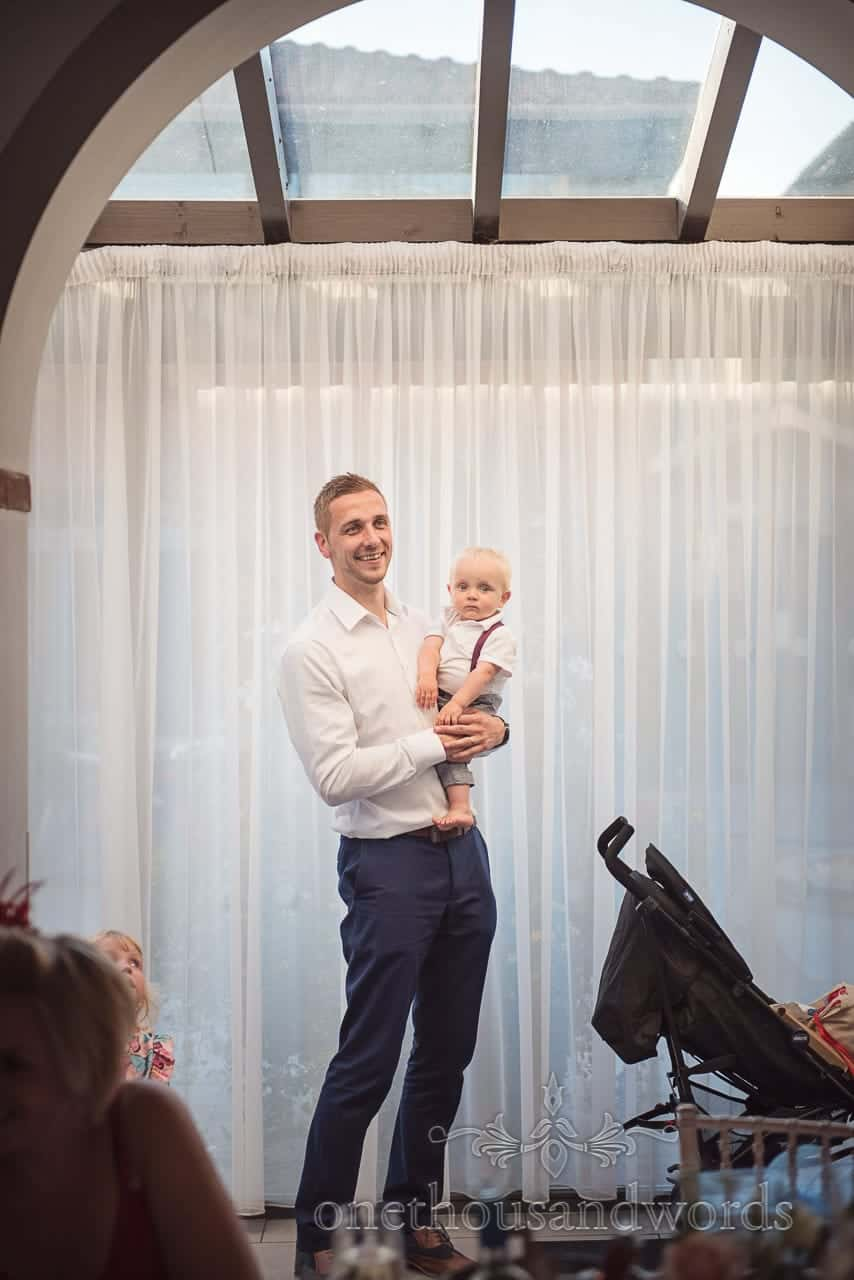 Guest with baby during speeches at Italian Villa Wedding
