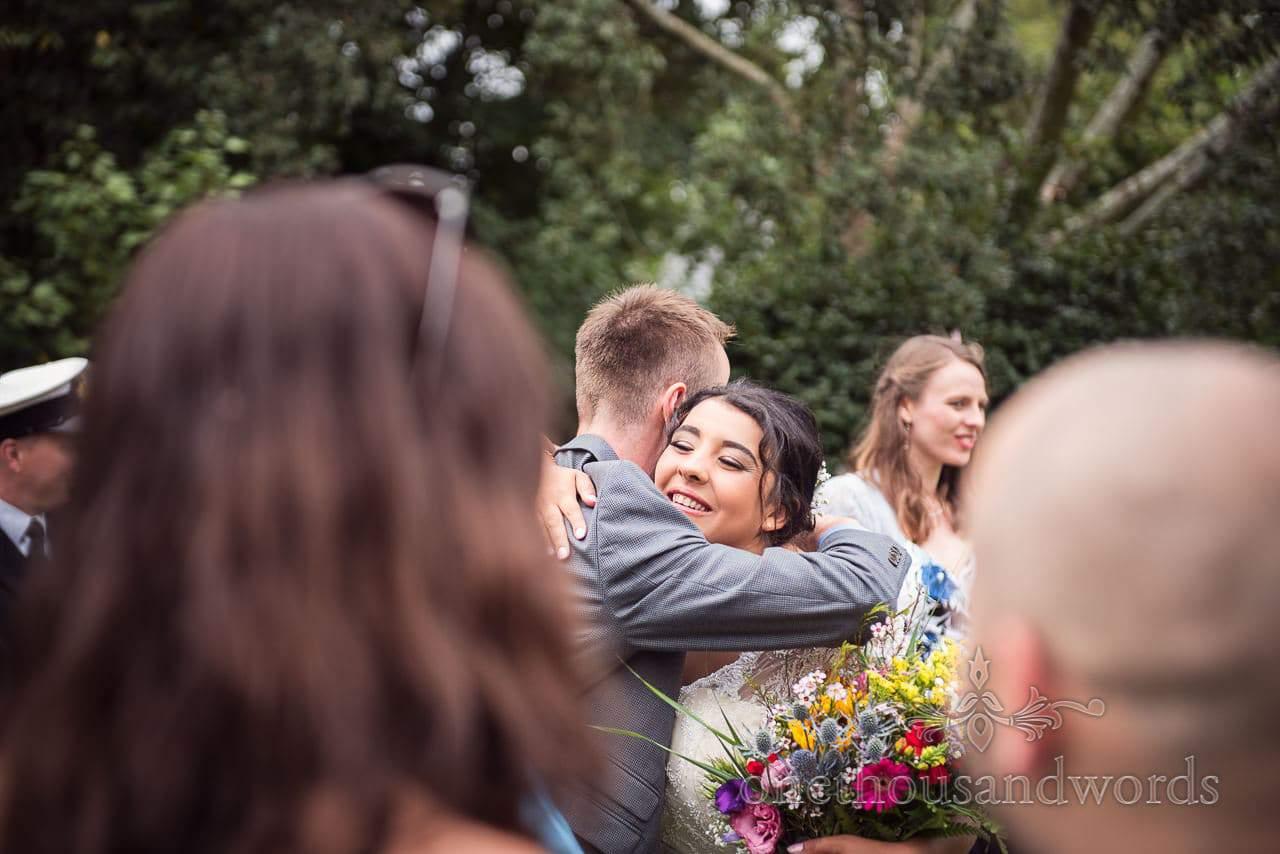 Guest congratulates the bride at Dorset garden wedding