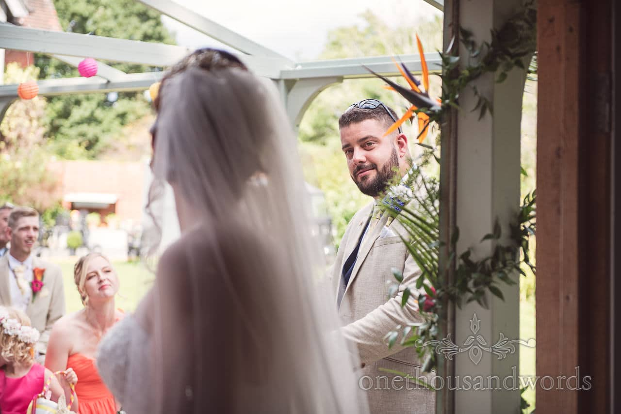 Guest delivers reading at outdoor ceremony at The Old Vicarage Wedding