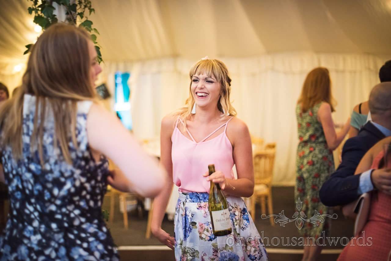 Guest on dance floor during evening wedding reception