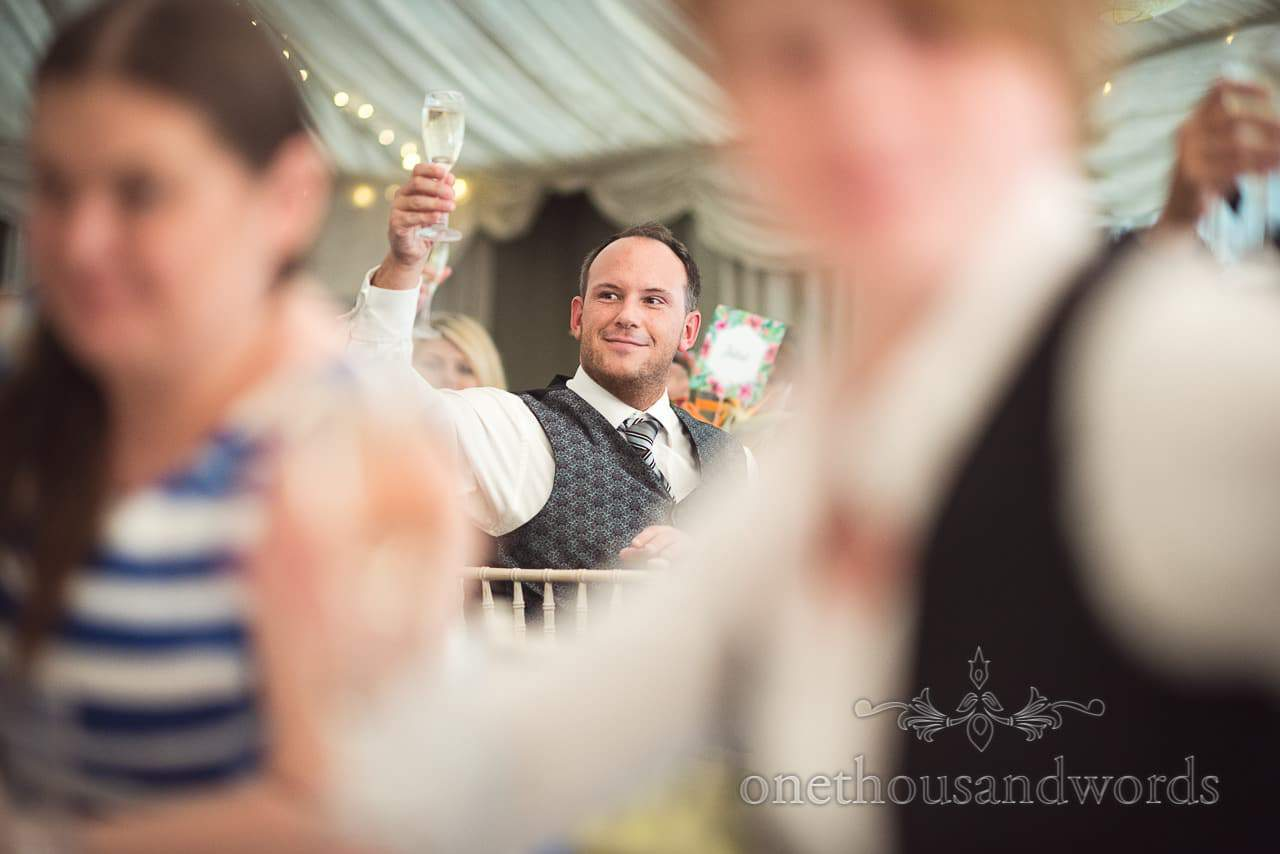 Guest raises a glass to toast at The Old Vicarage Wedding